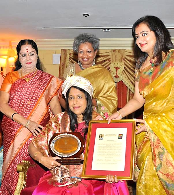 "Indian film playback singer Kavita Krishnamurthy being felicitated by actress Sumalatha and others during ""Phenomenal Women That's Me"" - a Five-Day Long Art Show in Bangalore on June 19, 2014. - Sumalatha"