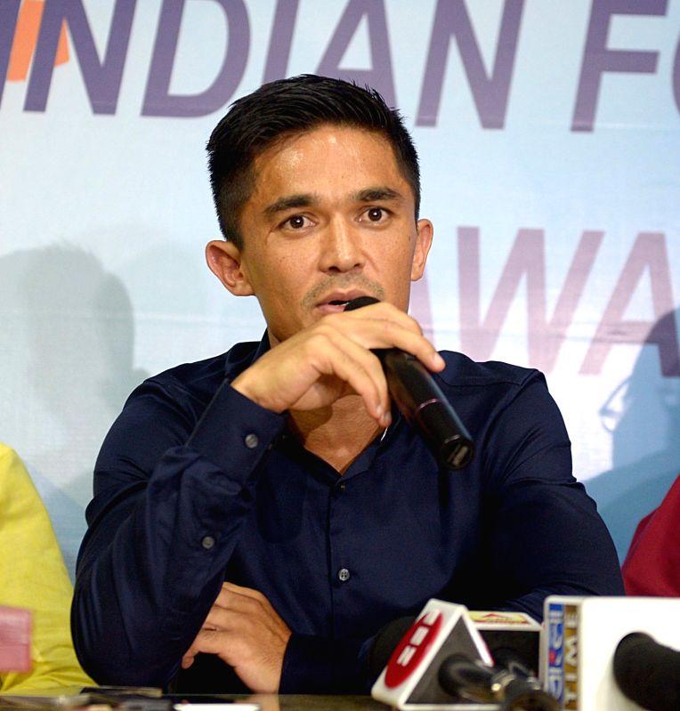 Indian football captain Sunil Chhetri addresses a press conference in Kolkata, on June 11, 2018. - Sunil Chhetri