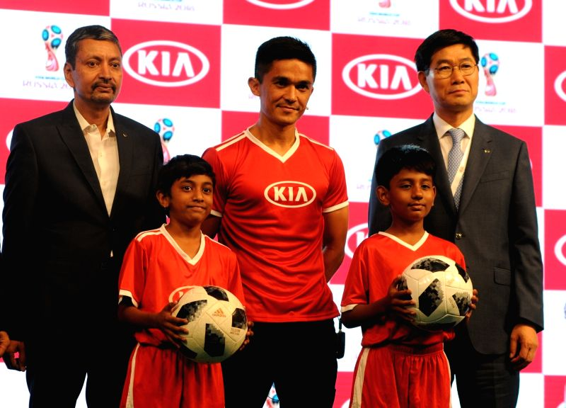 Indian football captain Sunil Chhetri with the Official Match Ball Carriers at FIFA 2018 during a press conference in New Delhi, on June 11, 2018. - Sunil Chhetri