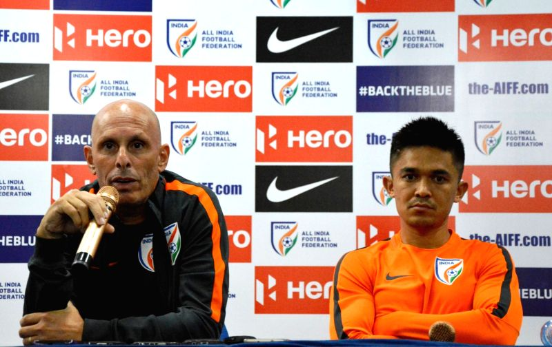 Indian Football Coach Stephen Constantine addresses a press conference with captain Sunil Chhetri at Sree Kanteerava Stadium in Bengaluru on June 12, 2017. - Sunil Chhetri