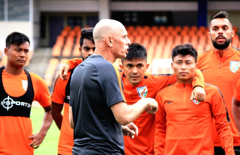 Indian Football Coach Stephen Constantine with players during a practice session at Sree Kanteerava Stadium in Bengaluru on June 12, 2017.