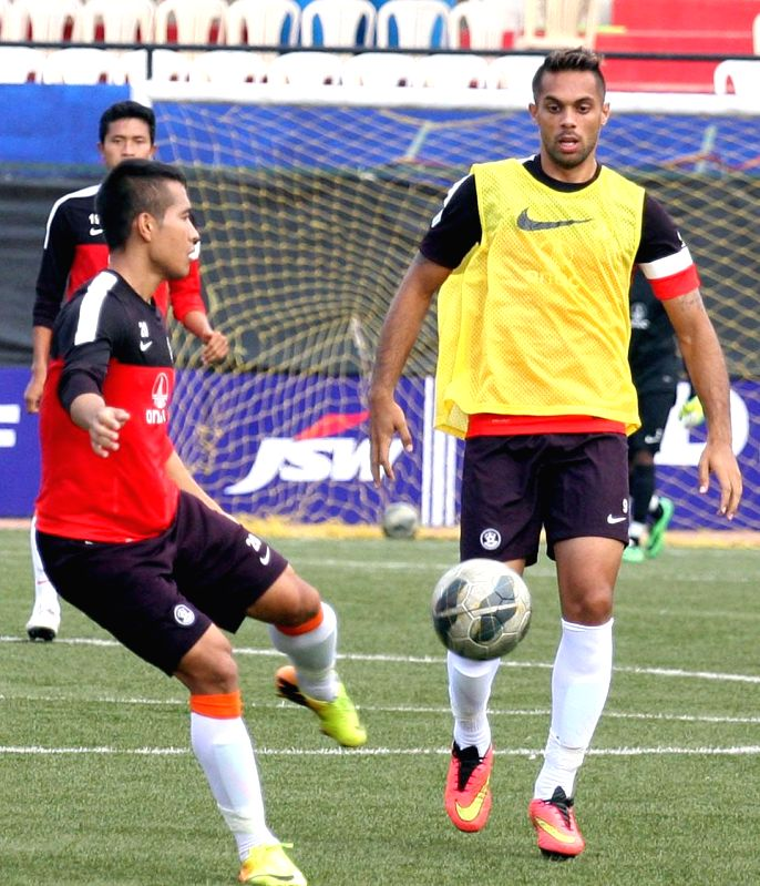 Indian footballers during a practice session at Bangalore Football Stadium in Bangalore on Aug 19, 2014.