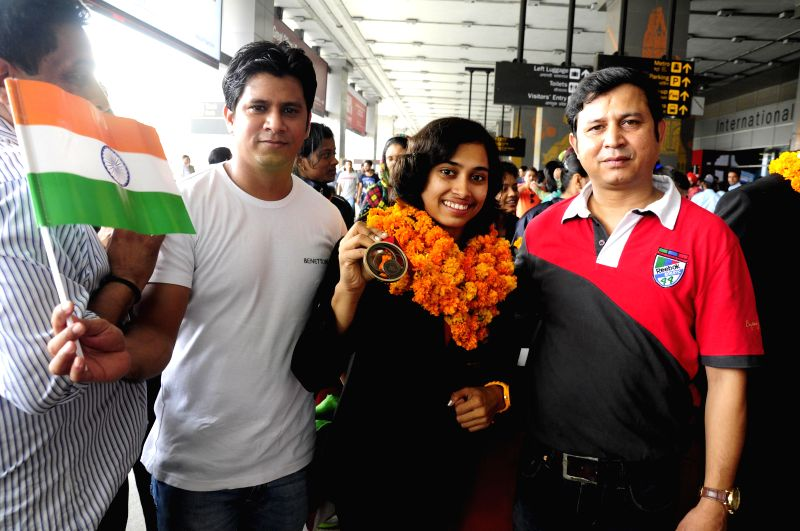 Indian gymnast Deepa Karmarkar who created history by winning bronze at the Commonwealth Games 2014 arrives at IGI stadium in New Delhi on Aug 3, 2014.