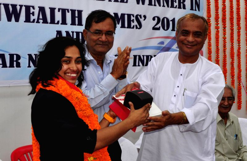 Indian gymnast Deepa Karmarkar, who created history by winning bronze at the Commonwealth Games 2014 being felicitated by Tripura Sports and Youth Affairs Minister Sahid Chowdhury in Agartala on Aug . - Sahid Chowdhury