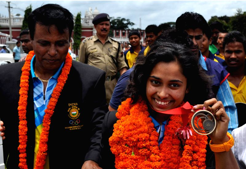 Indian gymnast Deepa Karmarkar who created history by winning bronze at the Commonwealth Games 2014 shows her medal in Agartala on Aug 4, 2014.