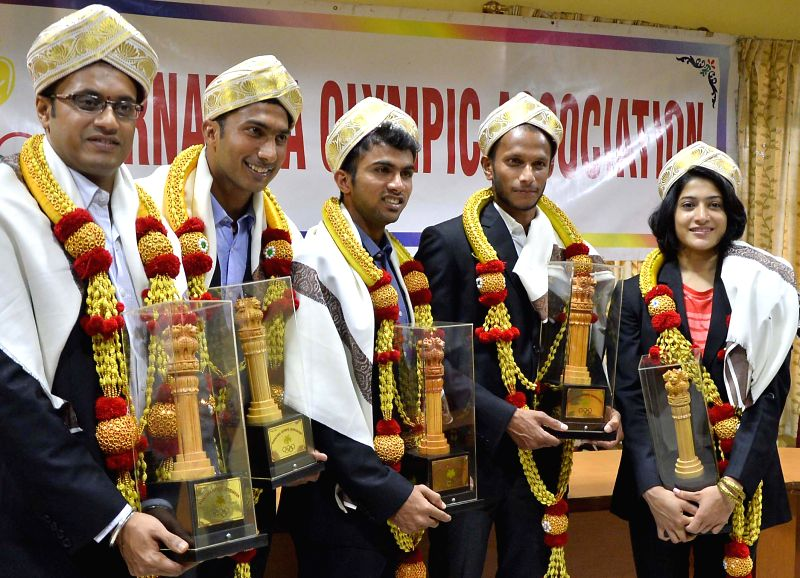 Indian hockey players V. R. Raghunath, Nikin Thimmaiah, SV Sunil, badminton player Ashiwini Ponnappa and shooter Prakash Nanajappa during a felicitation programme organised by Karnataka Olympic ...