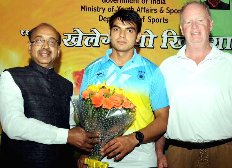 Indian Javelin thrower Neeraj Chopra being welcomed by Union Minister of State for Youth Affairs and Sports Vijay Goel in New Delhi on July 27, 2016. - Neeraj Chopra