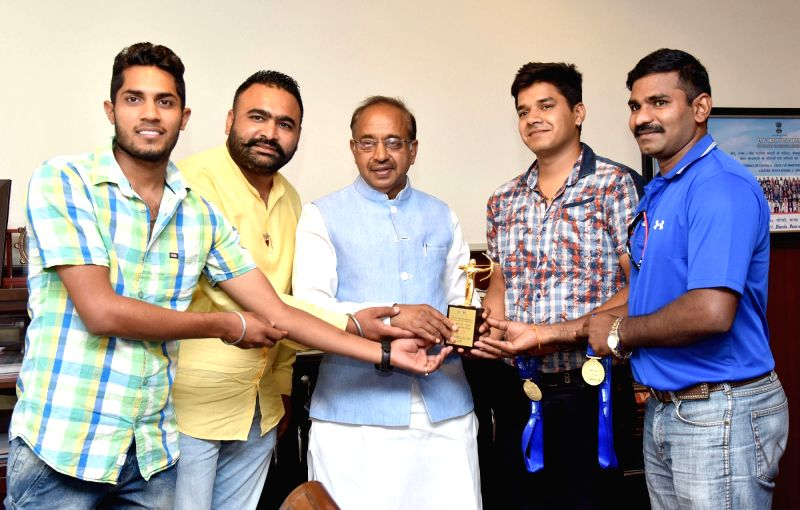 Indian men's Archery team that recently won Compound gold in Archery World Cup Stg.1 in Shanghai of China, calls on Union Sports Minister Vijay Goel, in New Delhi on May 24, 2017. - Vijay Goel