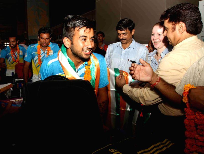 Indian Men's Hockey Team arrives at Indira Gandhi International Airport in New Delhi on Aug 5, 2014.