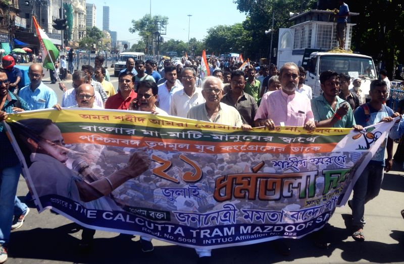 Indian National Trinamool Trade Union Congress (INTTUC) activists stage a protest to press for July 21st Martyr's Day Rally, in Kolkata, on July 19, 2018. July 21st  Martyr's Day Rally is an ...