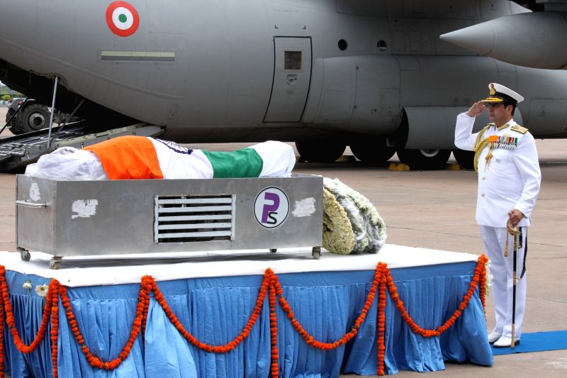 Indian Navy chief Admiral R K Dhowan pays tribute to former president APJ Abdul Kalam at Palam technical area of IGI Airport in New Delhi, on July 28, 2015.The former president died on ...