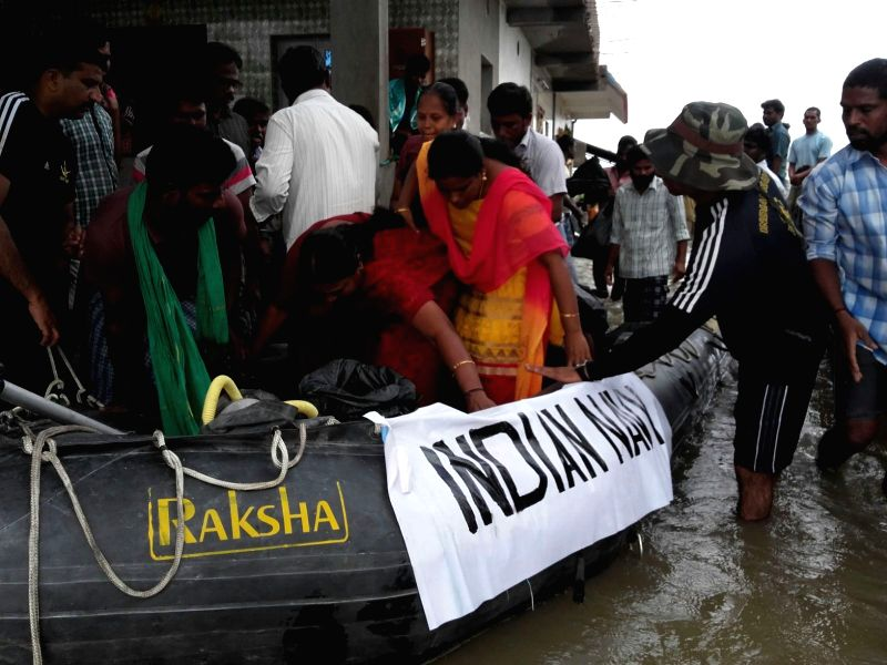 Indian Navy officials carry out rescue operations in flood affected Chennai on Nov 17, 2015.