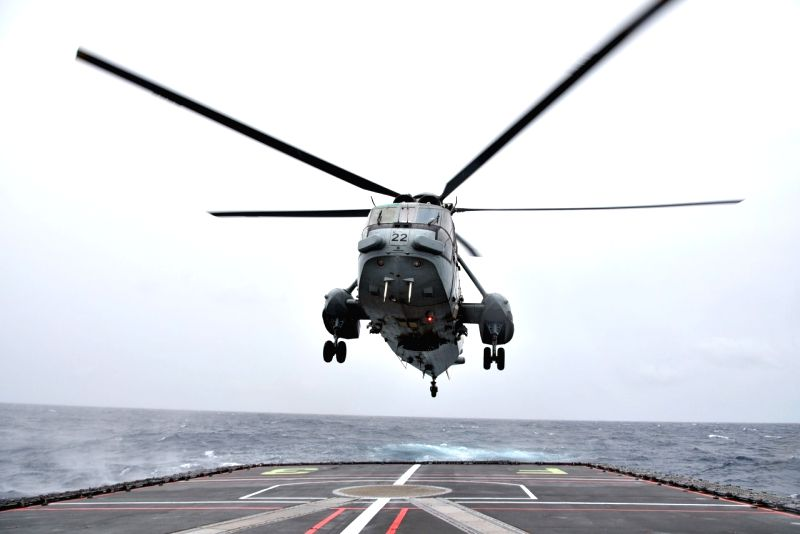 Indian Navy's Sea King helicopter being launched for transfer of JMSDF personnel to INS Vikramaditya during trilateral 'Malabar' naval exercise between India, the US and Japan in the Bay of ...