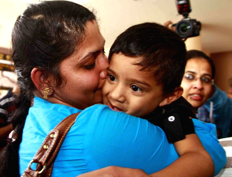Indian nurses who were trapped in violence hit Libya arrive at Kochi International Airport on Aug 5, 2014.