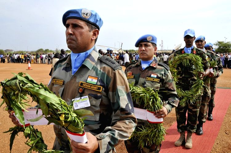 Indian peacekeepers with the United Nations Mission in South Sudan (UNMISS) hold a memorial ceremony for five of their colleagues who were killed in an ambush in April 2013. (Photo credit: UN/via ...