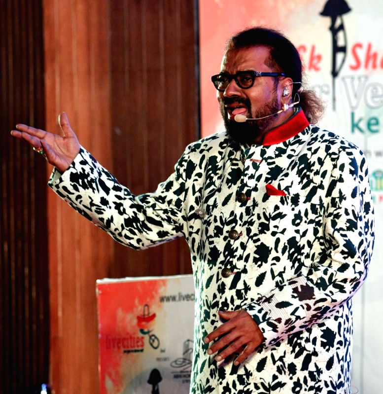 Indian playback singer Hariharan performs during a programme in Patna on Feb 23, 2018.