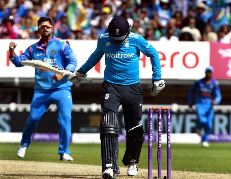 Indian player Suresh Raina celebrates Joe Root's dismissal in Birmingham, England on Sept 2, 2014.