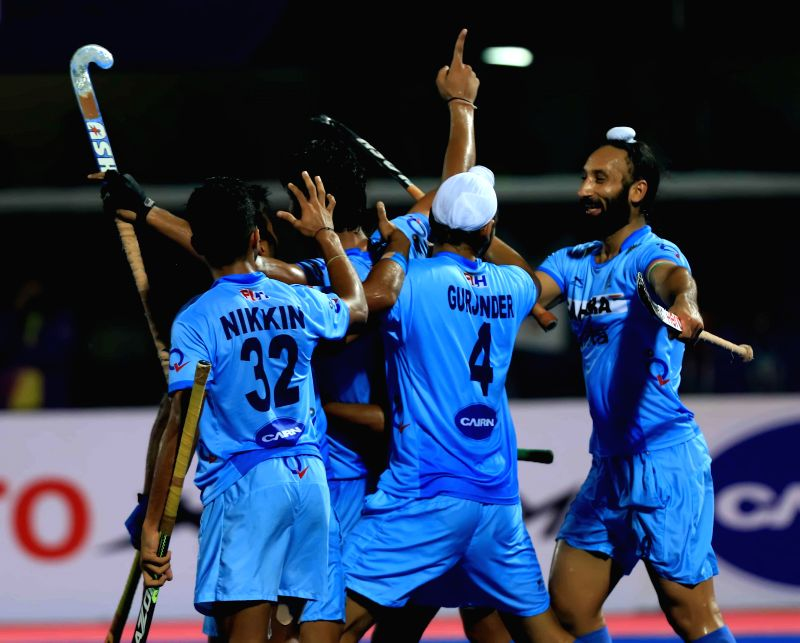Indian players celebrate after winning a  Hero Men`s Champions Trophy 2014 match against Netherlands by 3-2 at Kalinga Stadium in Bhubaneswar on Dec 9, 2014.