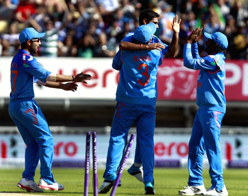 Indian players celebrate fall of a wicket during 4th ODI match between England and India in Birmingham, England on Sept 2, 2014.