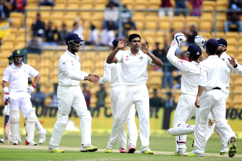 Indian players celebrate fall of a wicket during the first day of the second test match between India and South Africa at M Chinnaswamy Stadium in Bengaluru, on Nov 14, 2015.