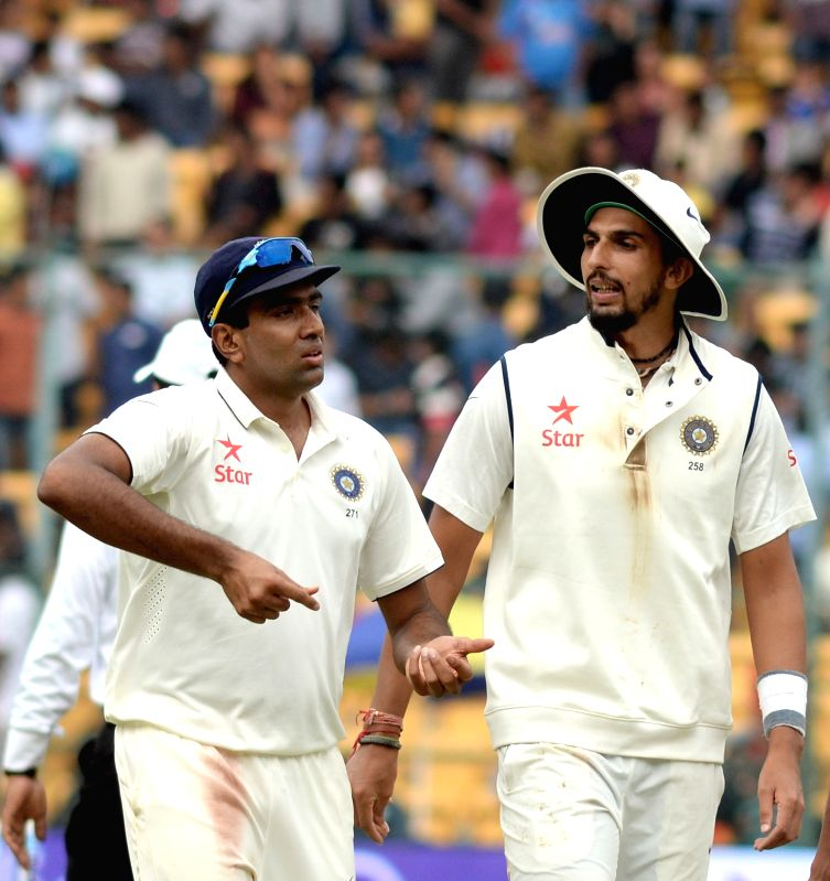 Indian players Ravichandran Ashwin and Ishant Sharma during the first day of the second test match between India and South Africa at M Chinnaswamy Stadium in Bengaluru, on Nov 14, 2015. - Ishant Sharma