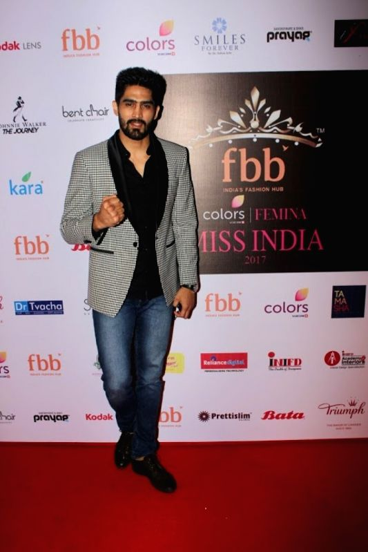 Indian professional boxer Vijender Singh during the event organised to reveal the 30 state finalist of Miss India in Mumbai, on June 2, 2017. - Vijender Singh