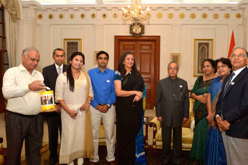 Indian Red Cross Society Chairperson Ameena Jung and others with President Pranab Mukherjee during Red Cross Flag Week at Rashtrapati Bhavan in New Delhi, on Nov 2, 2015. - Pranab Mukherjee