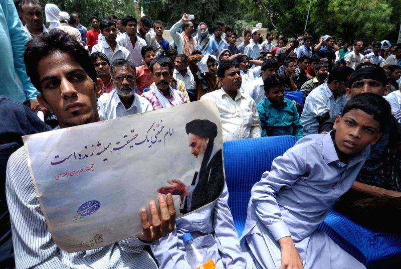 Indian Shia Muslims protesting against the killings of Shia Muslims in Iraq, in New Delhi on June 21, 2014.
