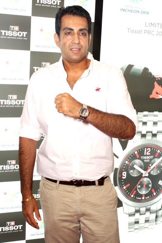 Indian sport shooter Manavjit Singh Sandhu at the launch of the` Tissot's Asian Games Collection, 2014 ` in New Delhi on Aug 21, 2014. - Manavjit Singh Sandhu