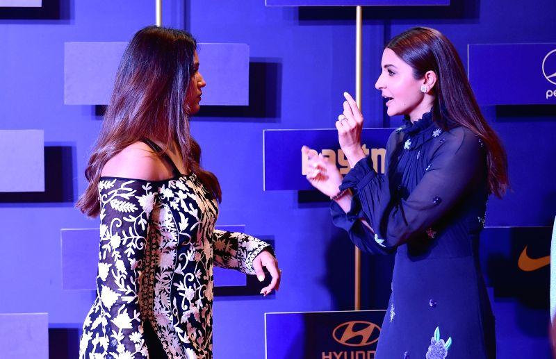 Indian squash player Dipika Pallikal and actress Anushka Sharma during BCCI annual awards in Bengaluru on June 12, 2018. - Anushka Sharma
