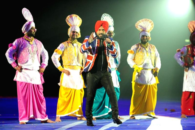 Indian stand-up comedian Gurpreet Guggi performs during the inaugural function of World  Kabaddi  League at O2 Arena in London, United Kingdom on Aug 10, 2014.
