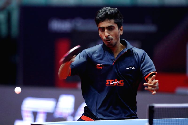 Indian table tennis player Gnanasekaran Sathiyan in action during 2017 ITTF World Tour India Open at Thyagaraj Sports Complex in New Delhi on Feb. 17, 2017.