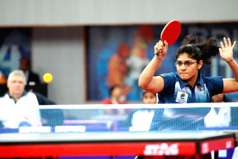:Indian table tennis player Madhurika Patkar in action during 3rd Lusofonia Games at Multipurpose Indoor Stadium in Peddem of Goa on Jan.20, 2014. (Photo: IANS).