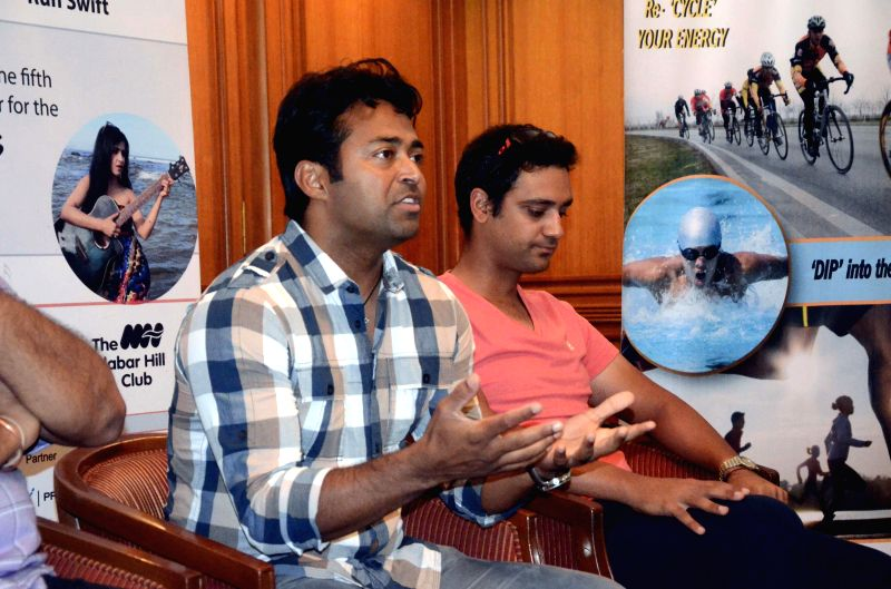 Indian tennis player Leander Paes and Indian swimmer Rehan Poncha during inauguration of Spirit of CCI Triathlon in Mumbai on April 13, 2014.