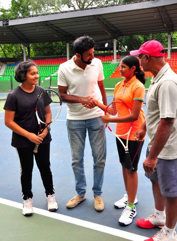 Indian Tennis player Rohan Bopanna celebrates his French Open mixed double victory at Karnataka State Lawn Tennis Association in Bengaluru, on June 10, 2017. - Rohan Bopanna
