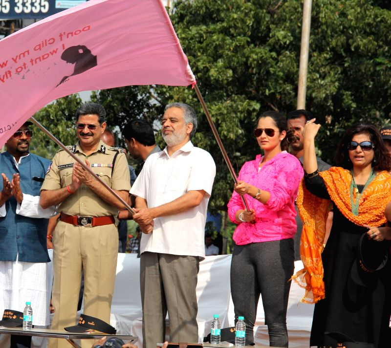 Indian tennis player Sania Mirza, Hyderabad Police Commissioner Anurag Sharma and others flag-off a rally against child sexual abuse in Hyderabad on Nov 19, 2014.
