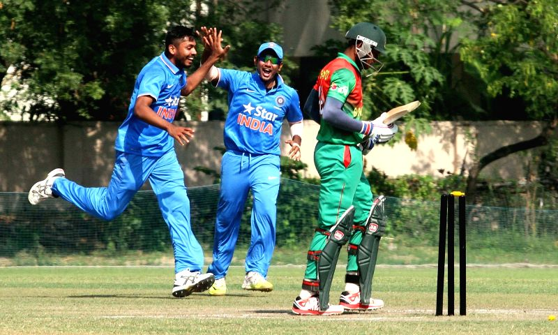 Indian under 19 cricketer Avesh Khan celebrates fall of a wicket during a under 19 cricket One Day match between Indian and Bangladesh in Kolkata on Nov 20, 2015. - Avesh Khan