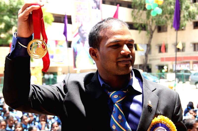 Indian weightlifter Sathish Sivalingam who won gold in Glasgow 2014 Commonwealth Games during a felicitation programme in Chennai on Aug 11, 2014.
