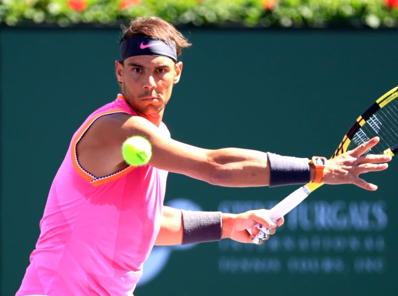 INDIAN WELLS, March 16, 2019 (Xinhua) -- Rafael Nadal of Spain hits a return during the men's singles quarterfinal match against Karen Khachanov of Russia at the BNP Paribas Open tennis tournament in Indian Wells, the United States, March 15, 2019. N