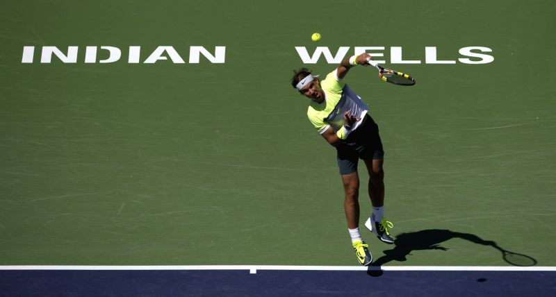 Rafael Nadal of Spain serves during the men's quarterfinal against Milos Raonic of Canada on day twelve of the BNP Paribas Open tennis at the Indian Wells ...