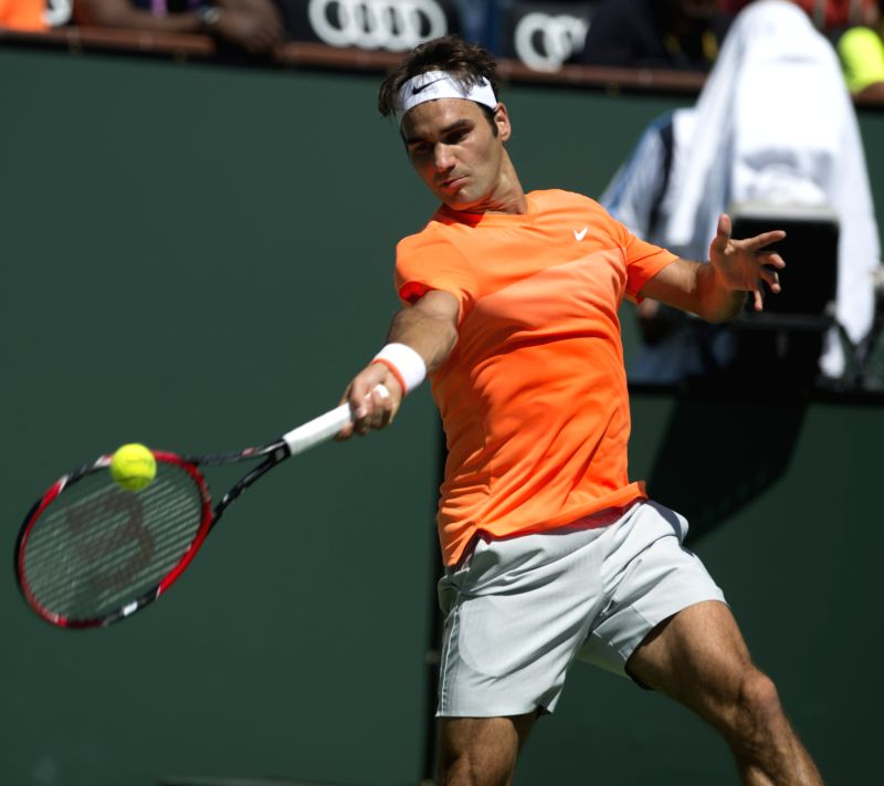 Roger Federer of Switzerland returns the ball during the men's quarterfinal against Tomas Berdych of Czech Republic on day twelve of the BNP Paribas Open ...