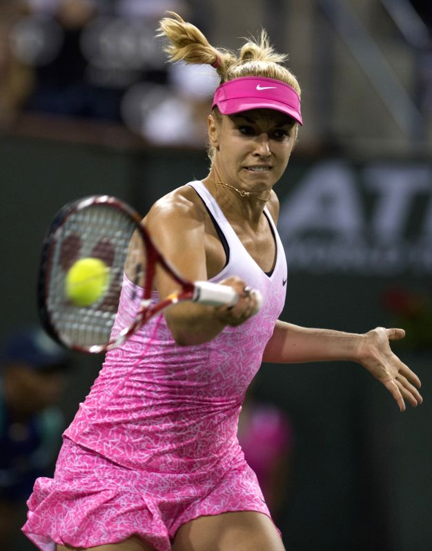 Sabine Lisicki of Germany returns the ball during the women's semifinal against Jelena Jankovic of Serbia on day twelve of the BNP Paribas Open tennis at the ...