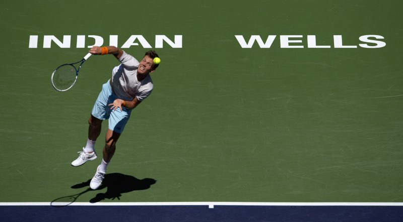 Tomas Berdych of Czech Republic serves during the men's quarterfinal against Roger Federer of Switzerland on day twelve of the BNP Paribas Open tennis at the ...