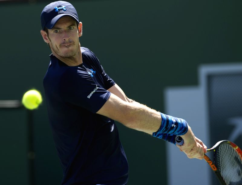 Andy Murray of Britain returns the ball during the men's semifinal match against Novak Djokovic of Serbia on the BNP Paribas Open tennis at the Indian Wells ...