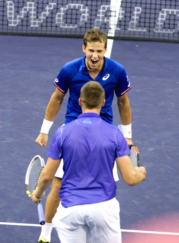 Vasek Pospisil (up) of Canada celebrates with Jack Sock of the United States after the men`s double final match against Italy`s Simone Bolelli and Fabio ...