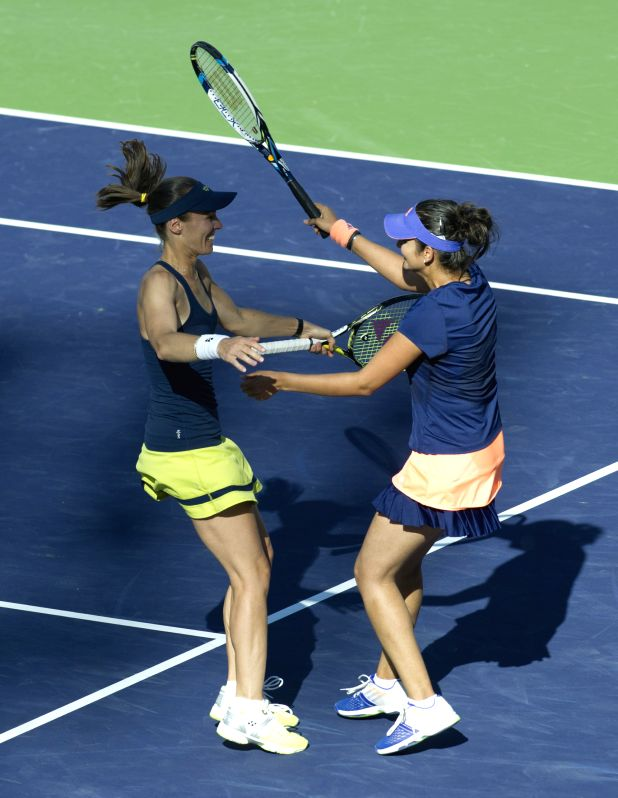 Indian Wells (USA): Martina Hingis and Sania Mirza in action during the Indian Wells BNP Paribas Open women's doubles final. Martina Hingis and Sania Mirza won a 2-0 victory over Russia's Elena ...