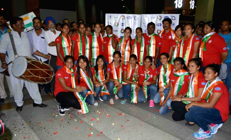 Indian women hockey team arrive at the Indira Gandhi International airport in New Delhi on July 6, 2015. India women hockey team finish 5th in the FINTRO Hockey World League at Belgium and ...