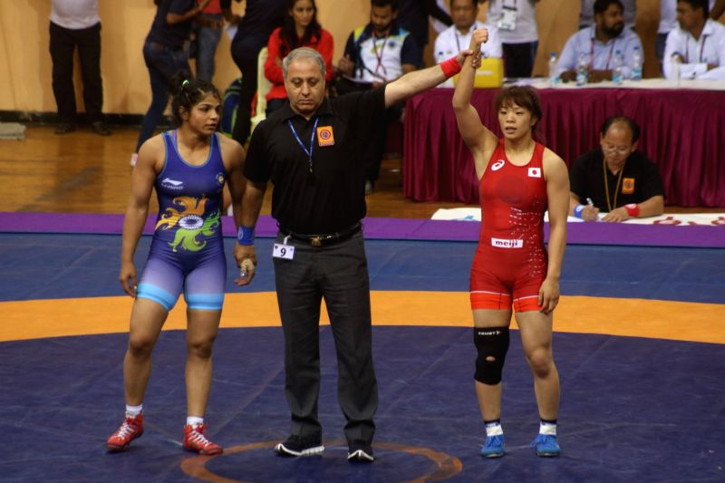 Indian wrestler Sakshi Malik during a match with Riisako Kawai  from Japan in action during senior 60Kg Asian Wrestling championship women final match held in New Delh on May 12, 2017. - Malik