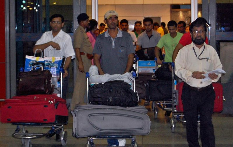 Indians who were trapped in violence hit Iraq arrive at IGI Airport in New Delhi on July 7, 2014.