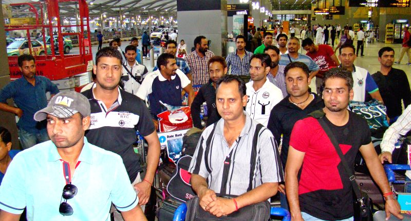 Indians who were trapped in violence hit Iraq arrive at IGI Airport in New Delhi on July 8, 2014.